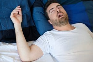 Man Sleeping With Sleep Apnea