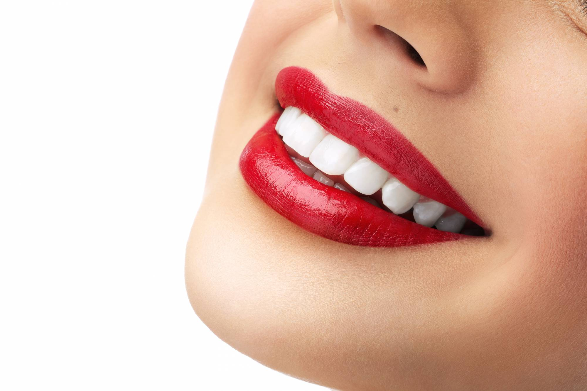 Closeup of woman with red lipstick and perfect teeth smiling